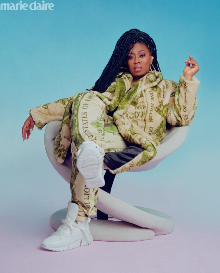 Rapper Missy Elliott poses in Moschino jacket and pants with Chloe sneakers
