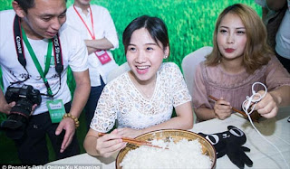 Petite Chinese woman devours NINE POUNDS of rice in one sitting