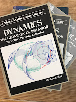 Dynamics: The Geometry of Behavior, by Ralph Abraham and Christopher Shaw, superimposed on Intermediate Physics for Medicine and Biology.