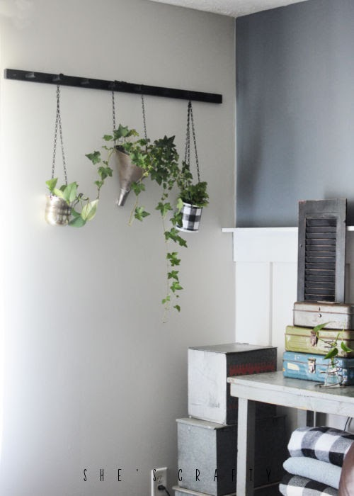 Hanging peg rack for plants in farmhouse living room