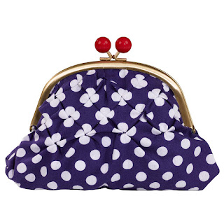 A blue and white polka dot clasp purse.