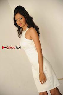 Kannada Actress Nidhi Latest Pos in White Short Dress at Vega Movie Launch Press Meet  0006.jpg