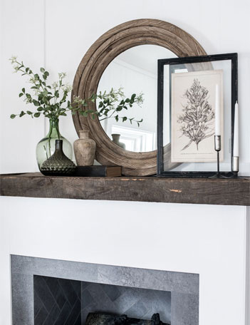Collection of decor on wood mantel