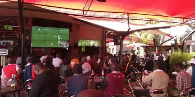 People watching football in a club in Nairobi photo