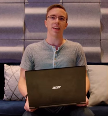 Austin Evans Holding The Acer Swift 7