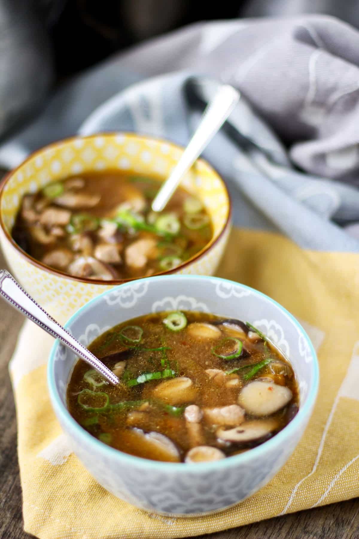 Hot and Sour Soup with Pork in bowls with spoons.