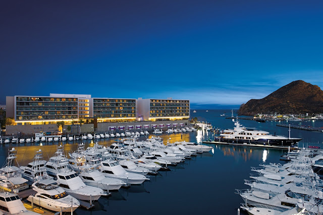 Overlooking the marina and perfectly situated on swimmable Medano Beach, the chic, adults-only Breathless Cabo San Lucas has location envy written all over it!