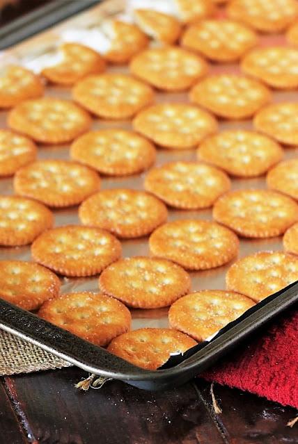 Ritz Crackers on Baking Sheet to Make Ritz Cracker Candy Image
