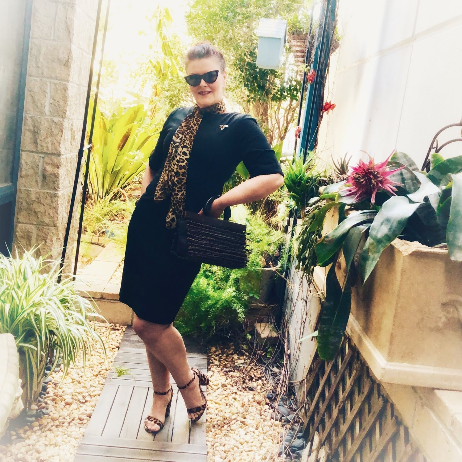 Australian blogger Donna in black with leopard skin.