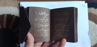 Al-Quran tinta emas
