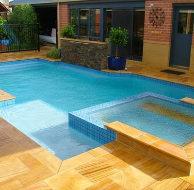 Picture of a block shaped swimming pool including a spar. This article is about 12 steps on how to build a swimming pool
