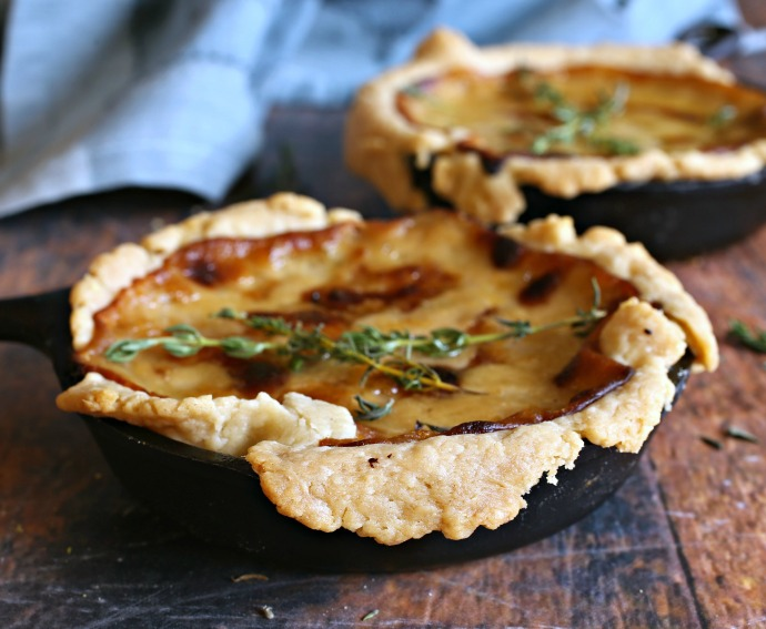 Recipe for cheesy sweet onion tarts in a buttery pastry crust.