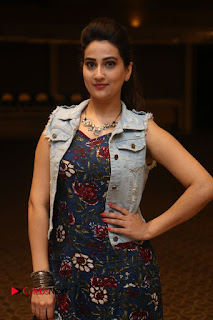 Manjusha in sleeveless backless flower print black gown at Intlo Deyyam Nakem Bhayam Trailer Launch