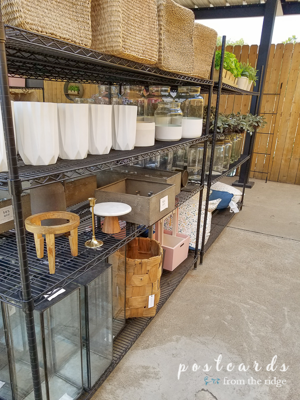store shelves full of vases and candle lanterns