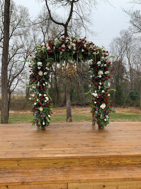 Red and White Flowers on a Wedding Arch