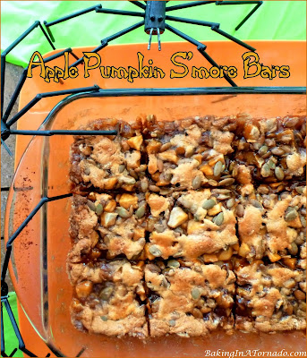 Apple Pumpkin S'more Bars, favorite fall flavors mixed with marshmallows, baked onto a shortbread crust. | Recipe developed by www.BakingInATornado.com | #recipe #Halloween