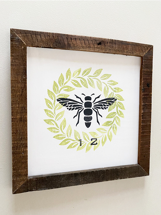 wreath and bee sign with a number 12