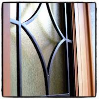 peinture grilles porte d'entrée vitrée