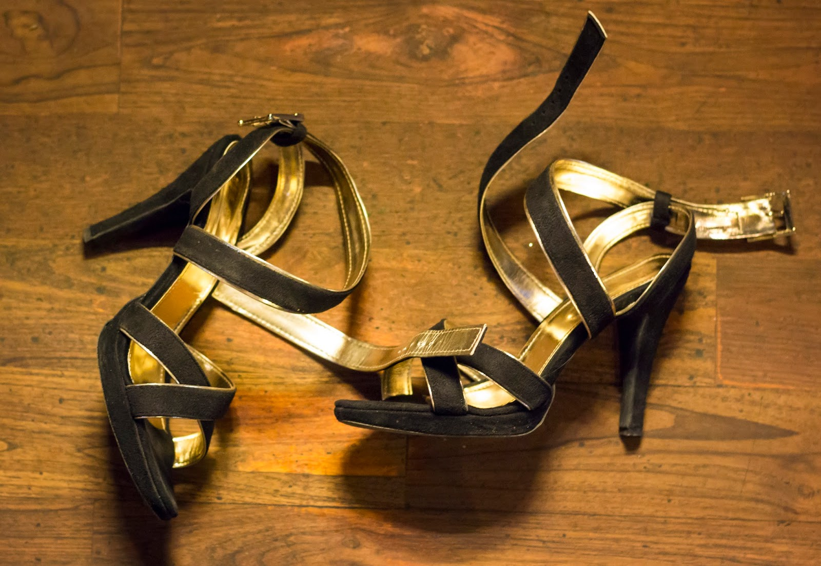 black and gold strappy high heels