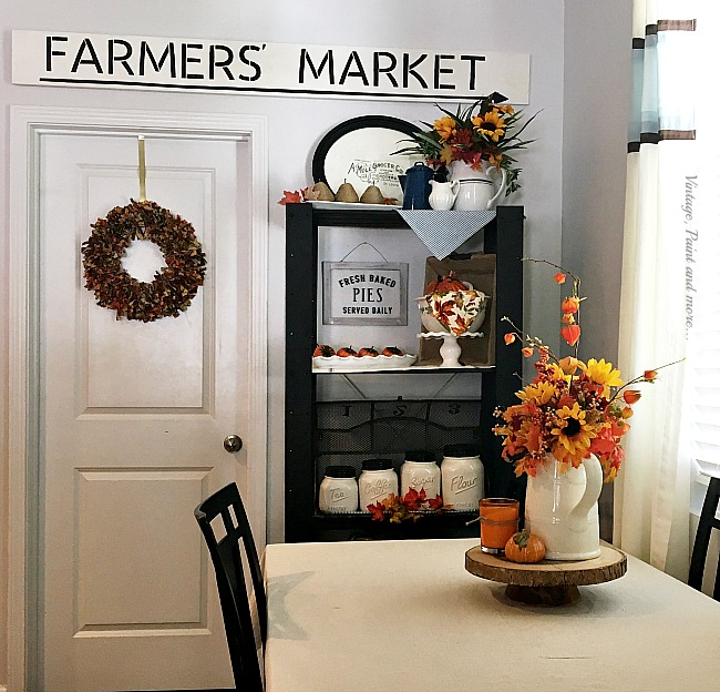 Vintage, Paint and more... kitchen decor changed for fall by using farmhouse pitchers, mason jar canister, pumpkins and faux foliage