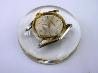 Paperweight containing an old watch