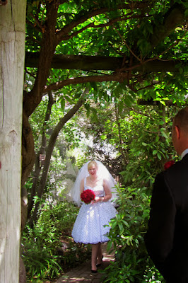 A gorgeous spring bride walks the garden path