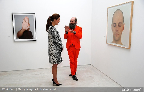 Catherine, Duchess of Cambridge talks to artist Gavin Turk about his painting 'Portrait of Something that I'll Never Really See' (R) during a visit to Turner Contemporary on March 11, 2015 in Margate, England