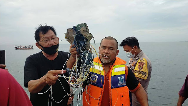 Indonesian passenger jet with 62 people on board goes missing after 'falling 10,000ft'  takeoff