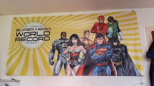 DC COmics Superhero dress up world record event banner on wall