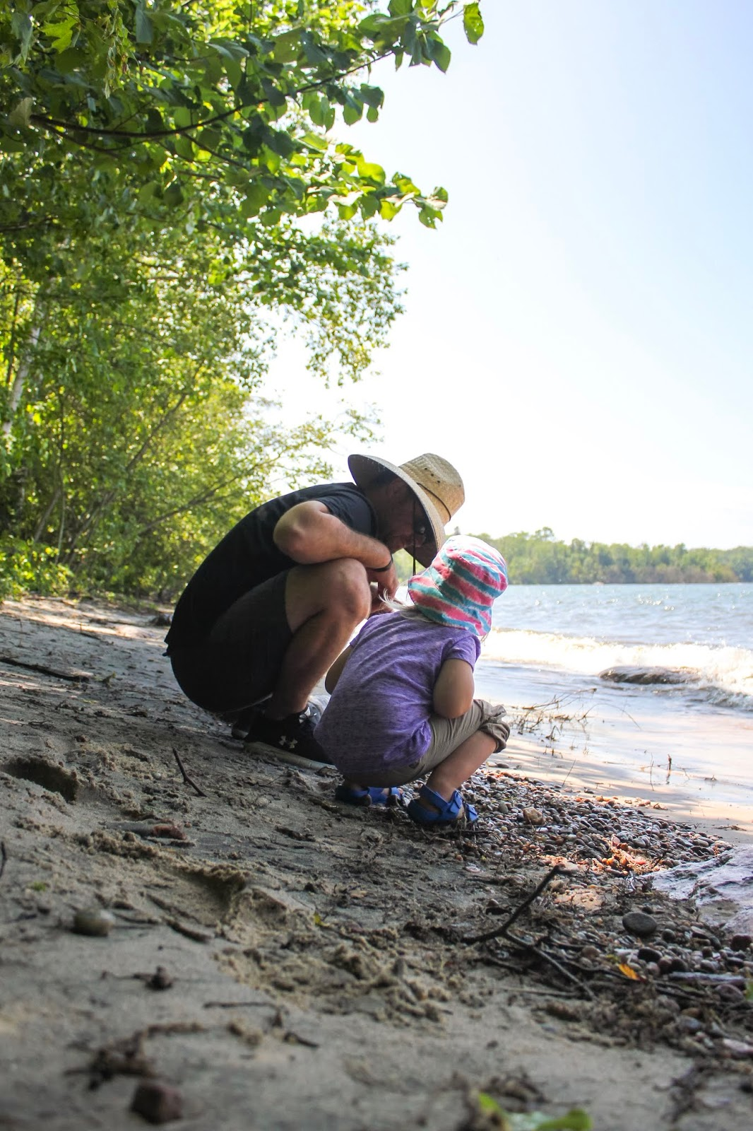 dad and daughter at beach at Awenda Provincial Park