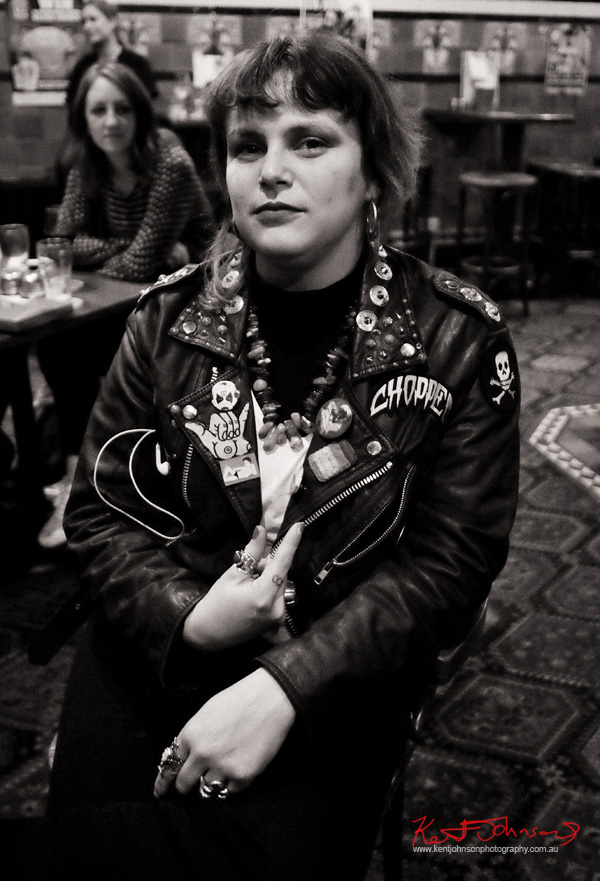 Leather jacket, patches, rings and tattooed fingers. Street Fashion Sydney - Photography by Kent Johnson.