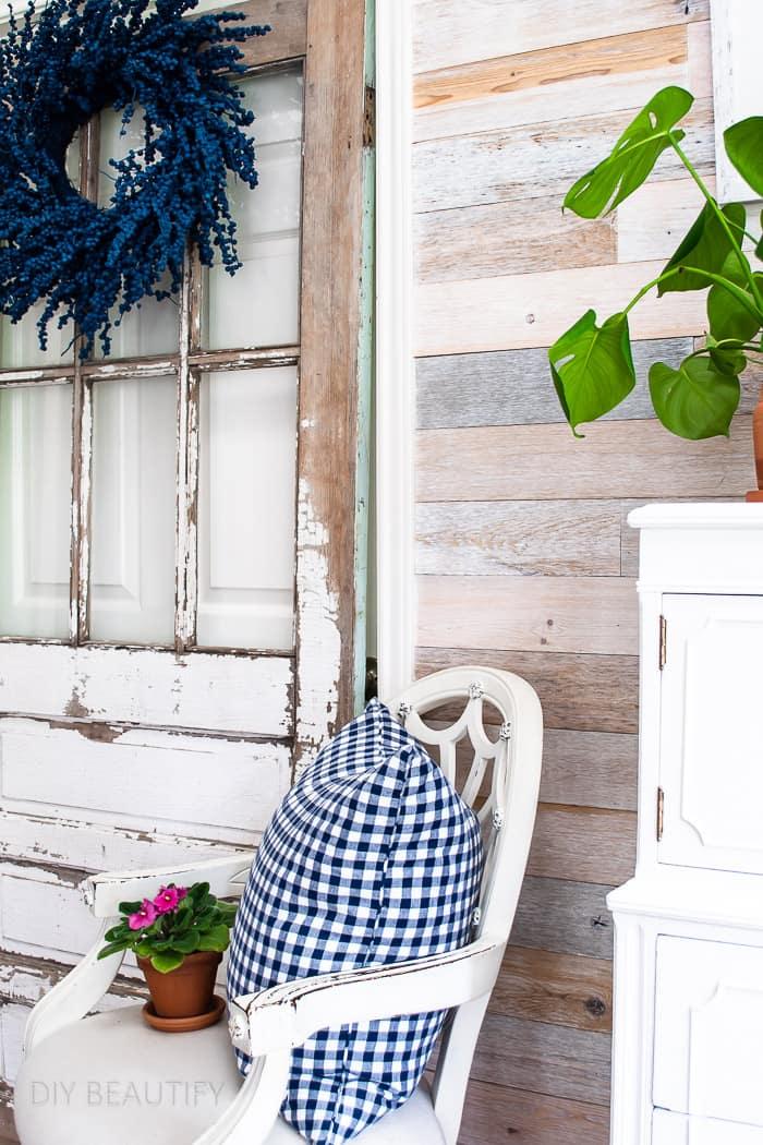 blue berry wreath hung on vintage door