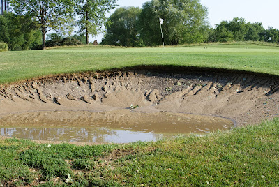 Golf Course sand trap bunker washed out after thunderstorm