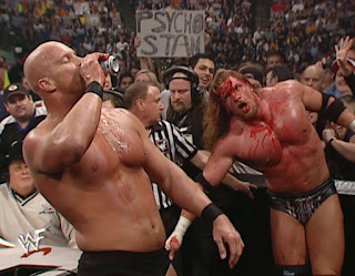 WWE / WWF Survivor Series 2000 - Steve Austin has a beer break before battering a bloody HHH