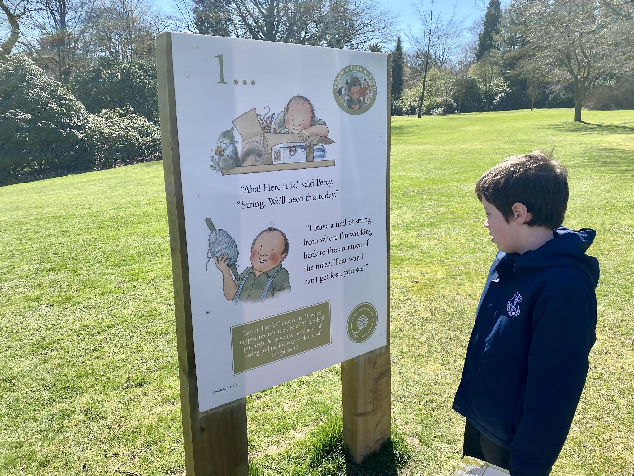 boy looking at a signpost