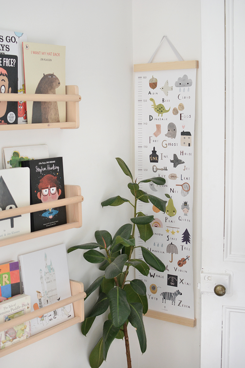 modern nursery decor with bookshelves and plants