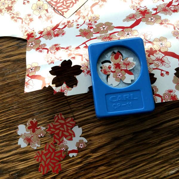 use a paper punch to make cherry blossoms for paper ornaments