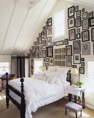 eclectic bedroom with many frames on the wall