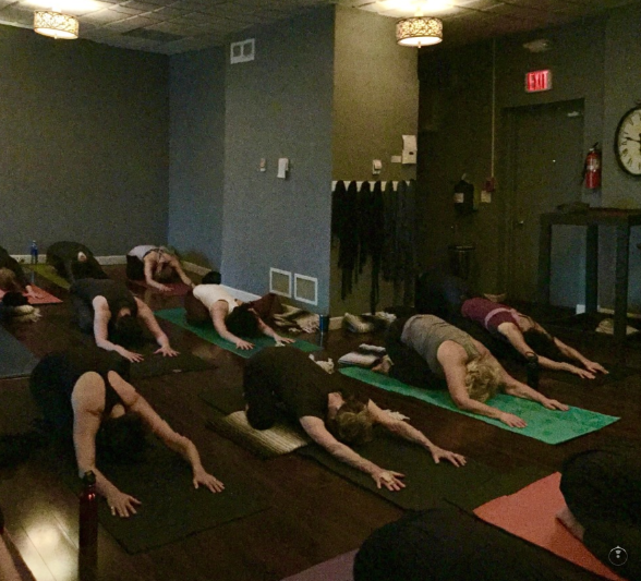 Practicing yoga at samadh, a yoga studio in glenview, Illinois image credit samadhi