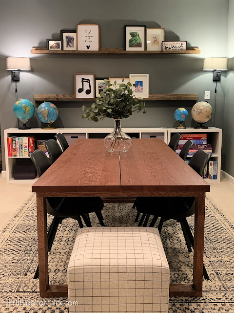Long wood table in basement game area