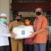 Wakil Ketua DPRD Sumbar Irsyad Syafar Serahkan Bantuan APD