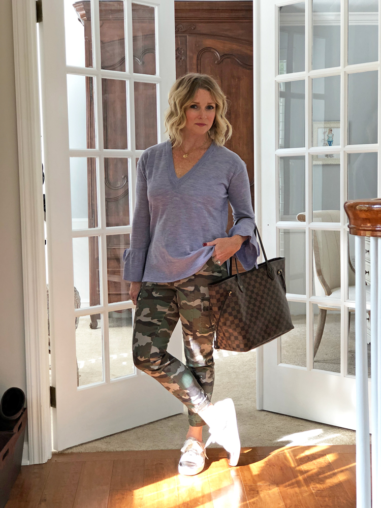 lavender sweater with camo pants and leopard print sneakers