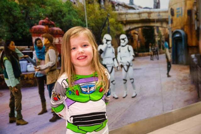 A child prepares to board a shuttle to the Main Terminal at Orlando International Airport, Nov. 16, 2019, in Orlando Fla. Disney installed artistic renderings on the terminal shuttle stations to bring the adventure of Star Wars: Galaxy's Edge at Disney's Hollywood Studios to airport travelers.