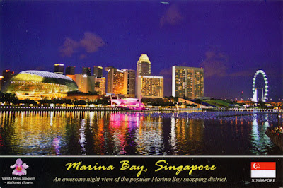 The north shore of Marina Bay, with Esplanade-Theatres  on the Bay, Marina Centre and Singapore Flyer