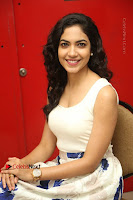 Actress Ritu Varma Stills in White Floral Short Dress at Kesava Movie Success Meet .COM 0177.JPG