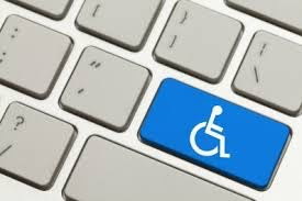 Picture of a gray computer keyboard with one key blue with a white wheelchair symbol