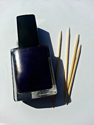 Purple nail varnish and some cocktail sticks