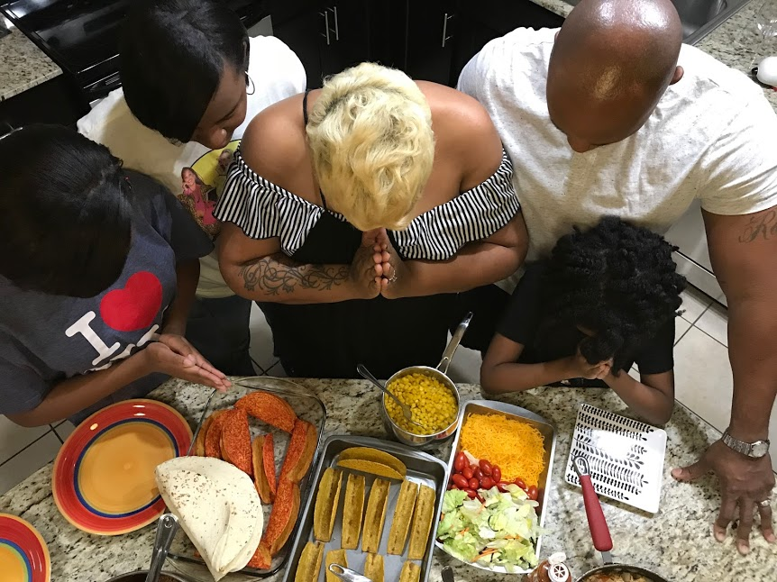 Image: Mom and Dad sharing their prayers and grace over a night of cooking food