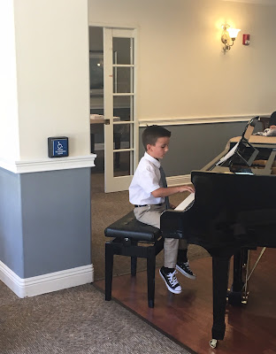 Student playing piano at an assisted living place