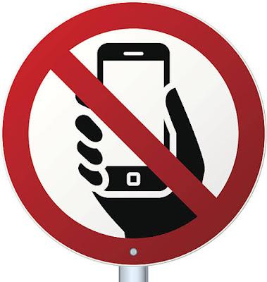 علامة تحذير من إستخدام الهاتف المحمول